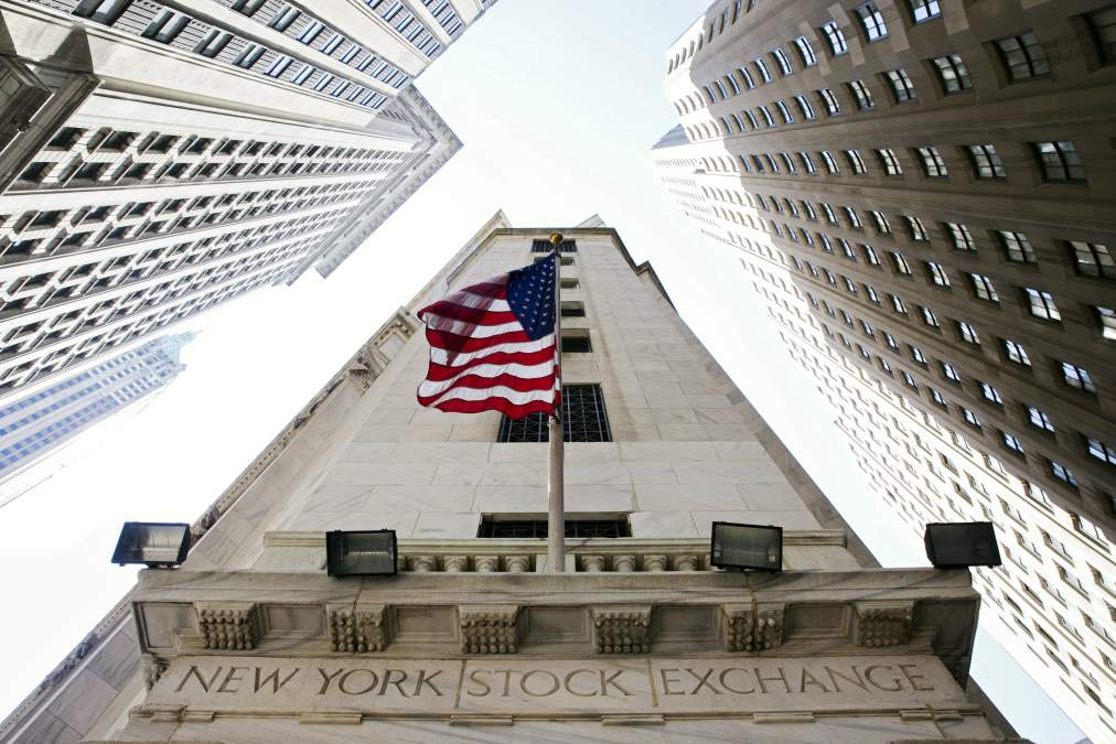 U.S. flag hangs above an entrance to the New York Stock Exchange